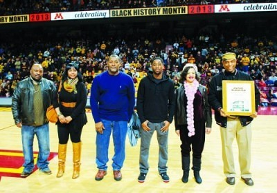 Kwame McDonald's family (l-r) Troy Russell, Shontel King, John Robinson, Robert Smaller, Jennifer Cobb,  and Mitchell Palmer McDonald, son (holding plaque), accepted award to honor him.                       Photo courtesy of U of M