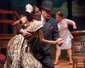 Austene Van and T. Mychael Rambo share a dance, Javeeta Steele (background) sings in SPUNK playing now through April 14 at the Penumbra Theatre in St.Paul Photo by Rich Ryan courtesy of the Penumbra Theatre