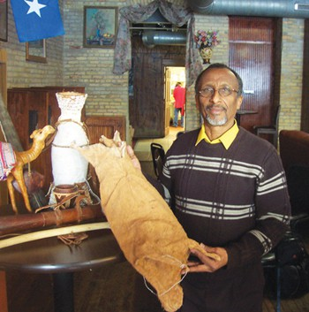 Osman Ali holding a sibraar, a traditional Somali goat skin milk container.  Photos by Jamal Denman