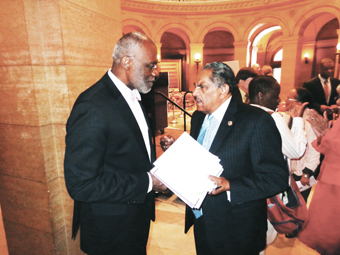Supreme Court Justice Alan Page (r) with Michael Mitchell  Photos by Charles Hallman