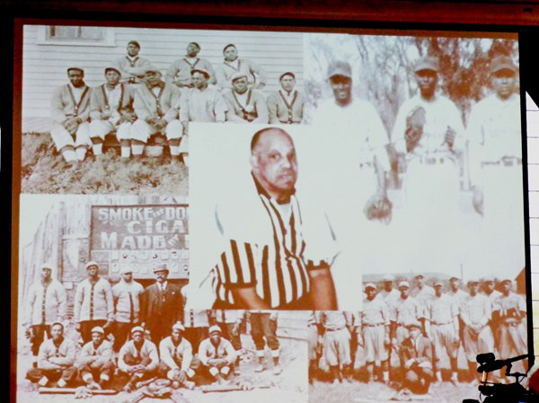 """Only known photo of Jim """"Jimmy"""" Lee with his teams as shown on overhead projector at induction ceremony Photo by  Charles Hallman"""