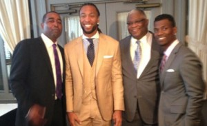 (l-r) Chris Carter with the Fitzgeralds: Larry, Jr., Larry, Sr. and Marcus Photo courtesy of www.Larry-Fitzgerald.com.