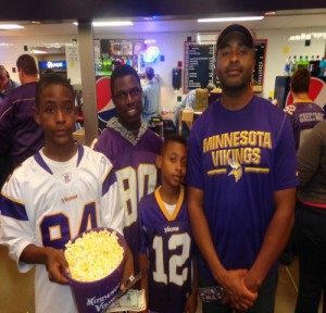 Local Vikings fans Maalik Harut (right) with (l-r) son Maalik, Jr., family friend Alphonso Gbalea, and son Maciah