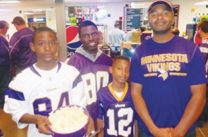 "Maalik Harut (r) of Minneapolis spent ""about $200 bucks"" on last Sunday's Vikings game with his two sons and a family friend. Photos by Charles Hallman"