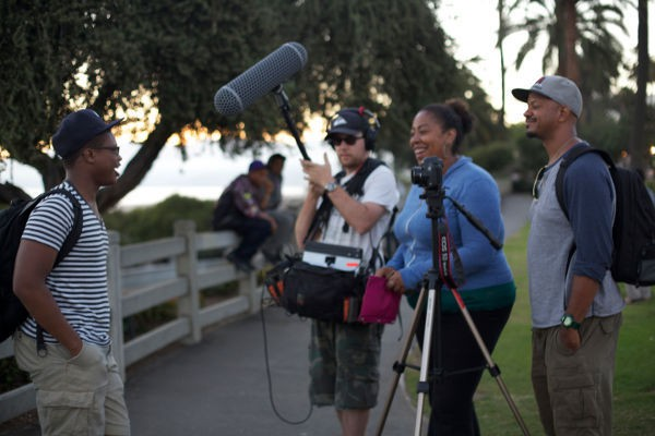 Director Angela Tucker (2nd from right) and crew on the scene.