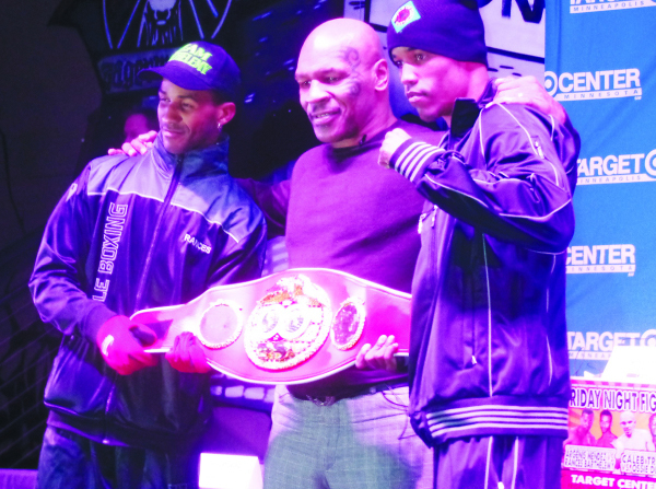 Mike Tyson, center, with fighters Rances Barthelemy (l) and Argenis Mendez, who contended for the Junior Lightweight  Championship Photos by Jamal Denman