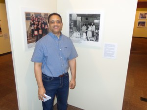 Minnesota Historical Society Exhibit Developer Ben Petry, standing in front of exhibition photos of (l-r) The Cato Shriners (1987) and Minnesota Spokesman-Recorder staff (approx. 1985) Photo by Charles Hallman