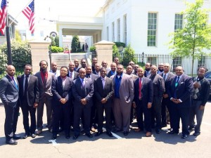 The collective 30 Black Men outside the White House; Ernest Comer III is third from right in the front row.