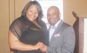 Award recipient TaShonda Williamson with Master of Ceremony Debonaire Photo by Brandi Phillips