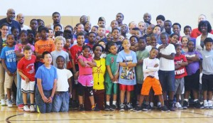 Clyde Turner (top left) poses with participants at his annual basketball camp. Photo by Mitchell Palmer McDonald