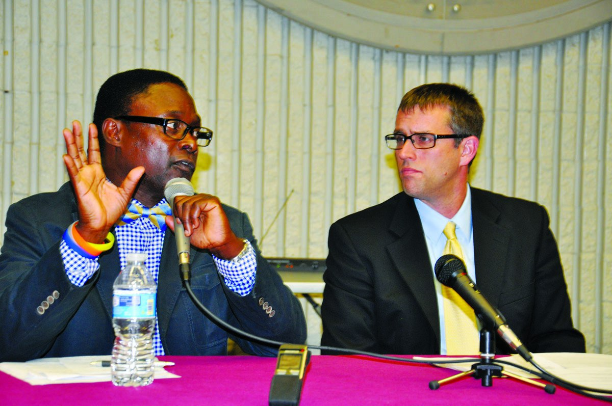 (l-r) Wynfred Russell and Dr. Aaron DeVris  Photos by Issa A. Mansaray