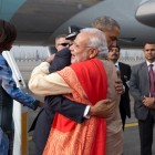 President Obama hugs Prime Minister Narendra Modi at Air Force Station Palam in New Delhi