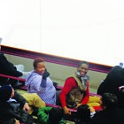 Gladys Kudzaishe Hlatywayo (right) and her husband enjoyed watching Gopher women's hockey.