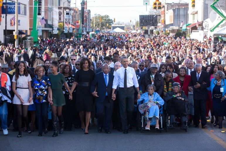 The Obama family join hands as they begin the march with the foot soldiers across the Edmund Pettus Bridge.