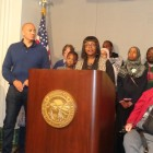 NOC Executive Director Anthony Newby (standing at left) and State Rep. Rena Moran (behind podium)