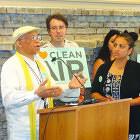 Louis Alemayehu at podium with Karen Monahan at right