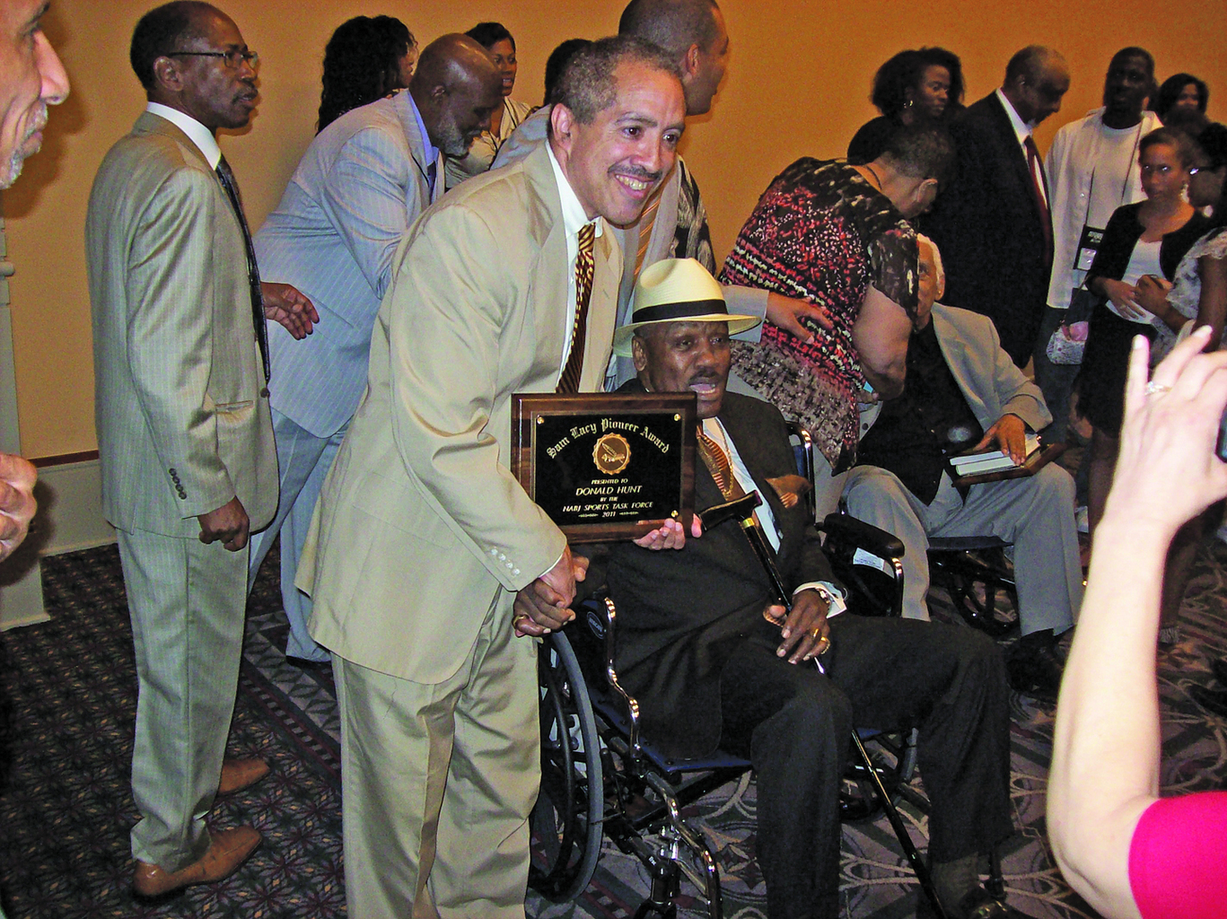 "Donald Hunt of the Philadelphia Tribune (see this week's ""In Our View"") with 2011 Sam Lacy Pioneer Award-winner Joe Frazier; Ron Thomas is standing at left."