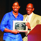 Briana Scurry accepts her award from Ron Thomas.
