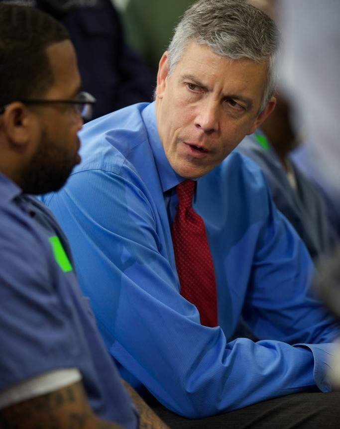 Education Secretary Arne Duncan speaks with Terrell Johnson, a participant in the Goucher College Prison Education Partnership at the Maryland Correctional Institution. (Flickr/Department of Education/CC BY 2.0)