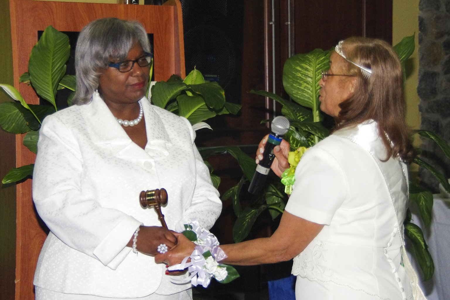 Stephanie Dilworth, left, is installed by outgoing Iota Phi Lambda president Phyllis Shumate.