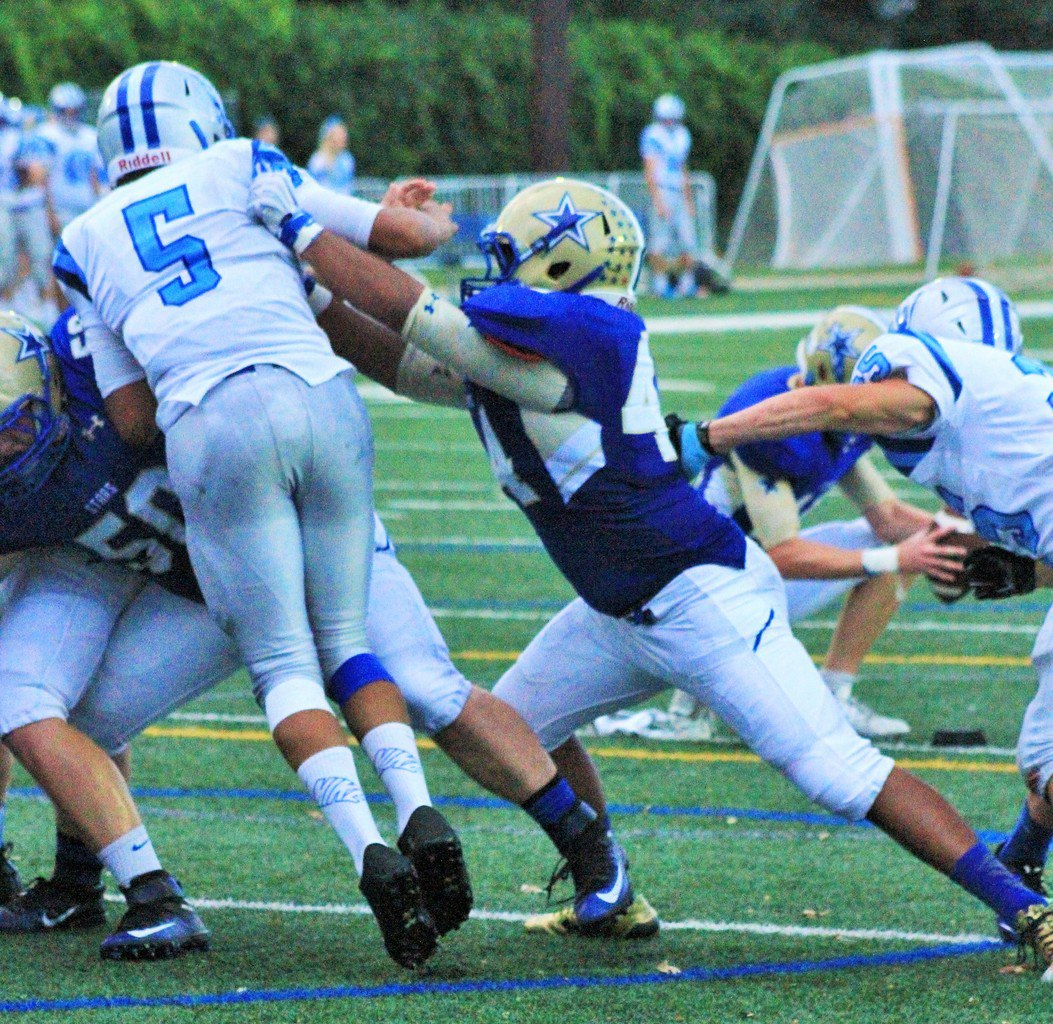 John Kipper (Holy Angels) blocks a Bloomington Jefferson player during an extra-point conversion.