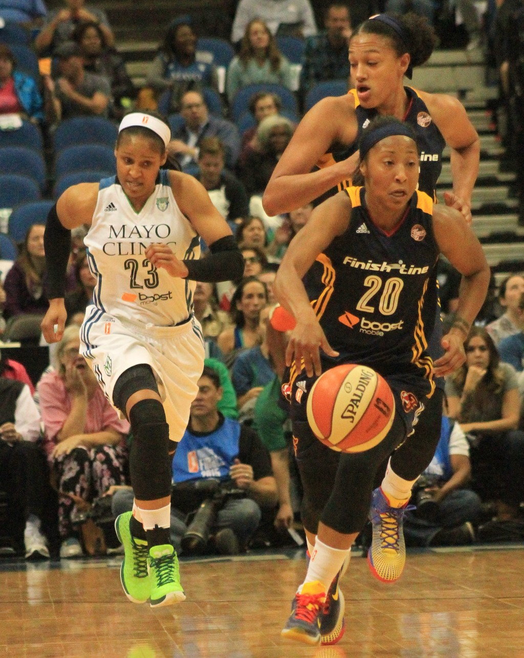 Fever guard Briann January (20) is chased by Lynx guard Maya  Moore (23) and Indiana teammate Marissa Coleman.