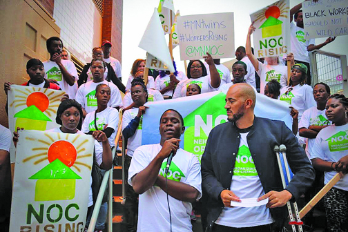 Temporary workers rallied with Neighborhoods Organizing for Change September 23.