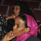 A Somali mother listens to one of the speakers