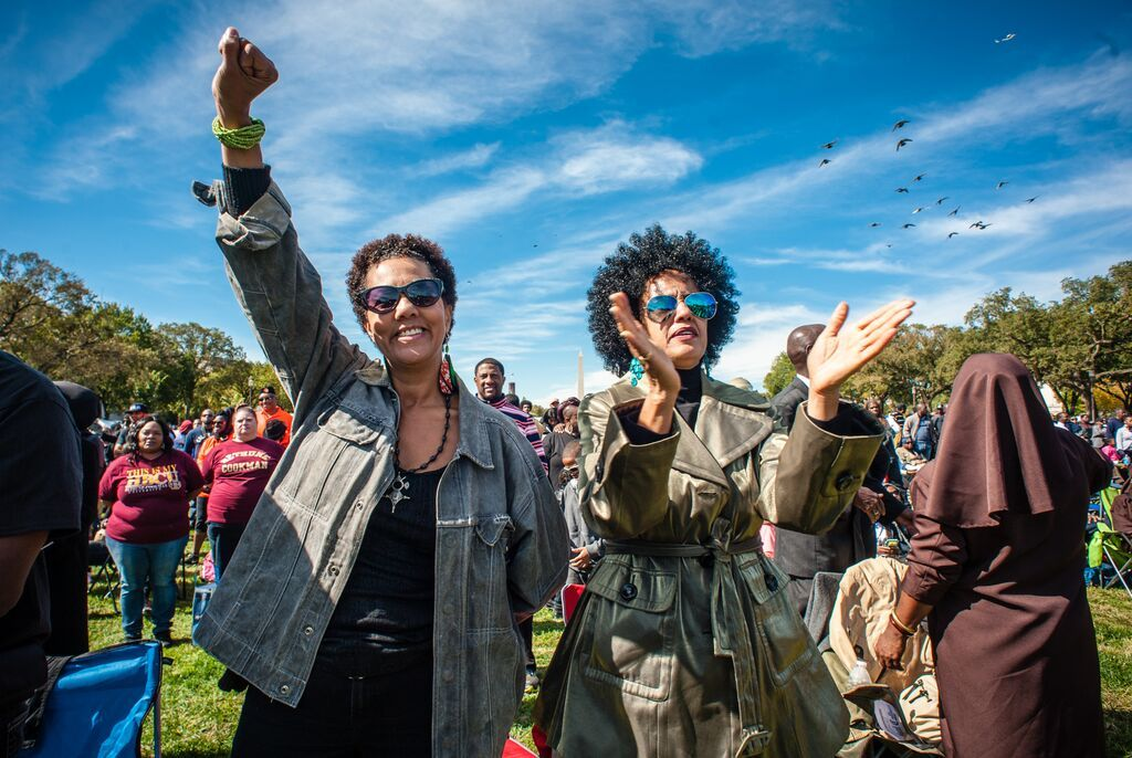 WASHINGTON, DC -- 10/10/15 -- Marsha Culler, left, and her sister, Carolyn Steptoe of Washington DC, show their solidarity during the rally. Justice or Else is the theme for the 20th Anniversary Million Man March at the National Mall. Minister Louis Farrakhan and the Nation of Islam drew hundreds of thousands to the nation's capital to draw attention to police brutality, oppression, and deliver a message of unity between African-Americans, Native-Americans and Latinos…