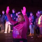 NAACP President Nekima Levy-Pounds with her hands up