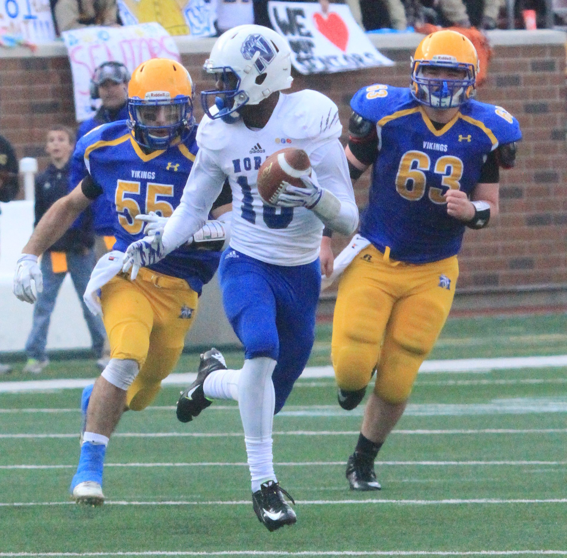 QB Tyler Johnson (10) dashes with two Mineota players in pursuit.