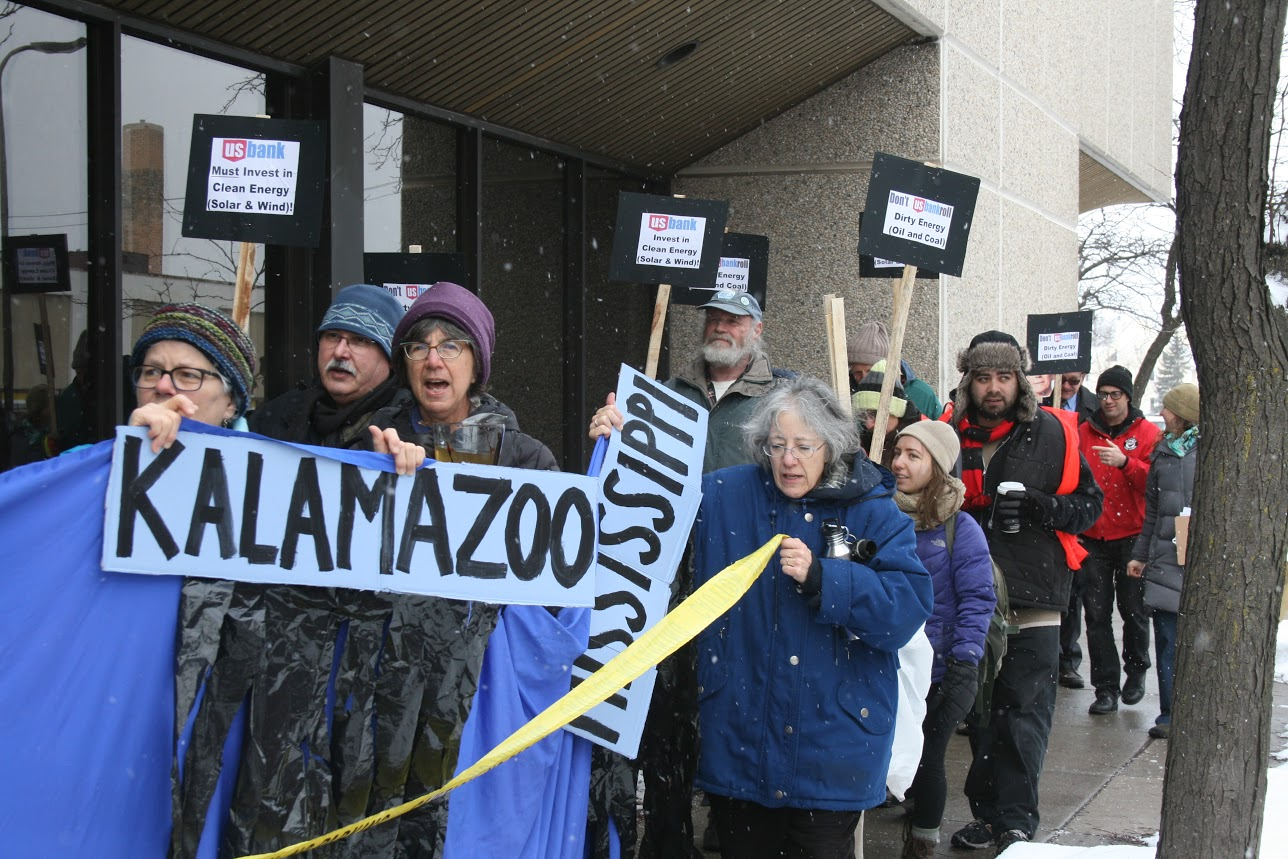 Members of the local climate change activist group MN350 rallied at US Bank on the corner of Hennepin and University in Minneapolis on January 26.
