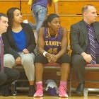 LaShay Holt (center) usually sits between two team assistant coaches at the start of games, raring to go. Coach Sean Pinkerton is at far left.