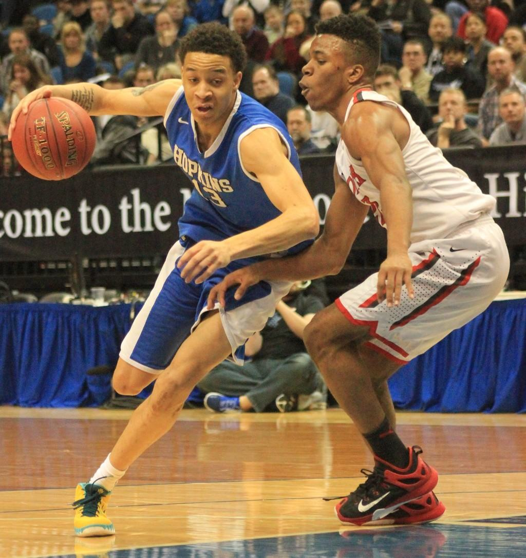 Hopkins' Amir Coffey drives past North St. Paul's Joe Johnson during the Royals' Class AAAA quarterfinal victory.