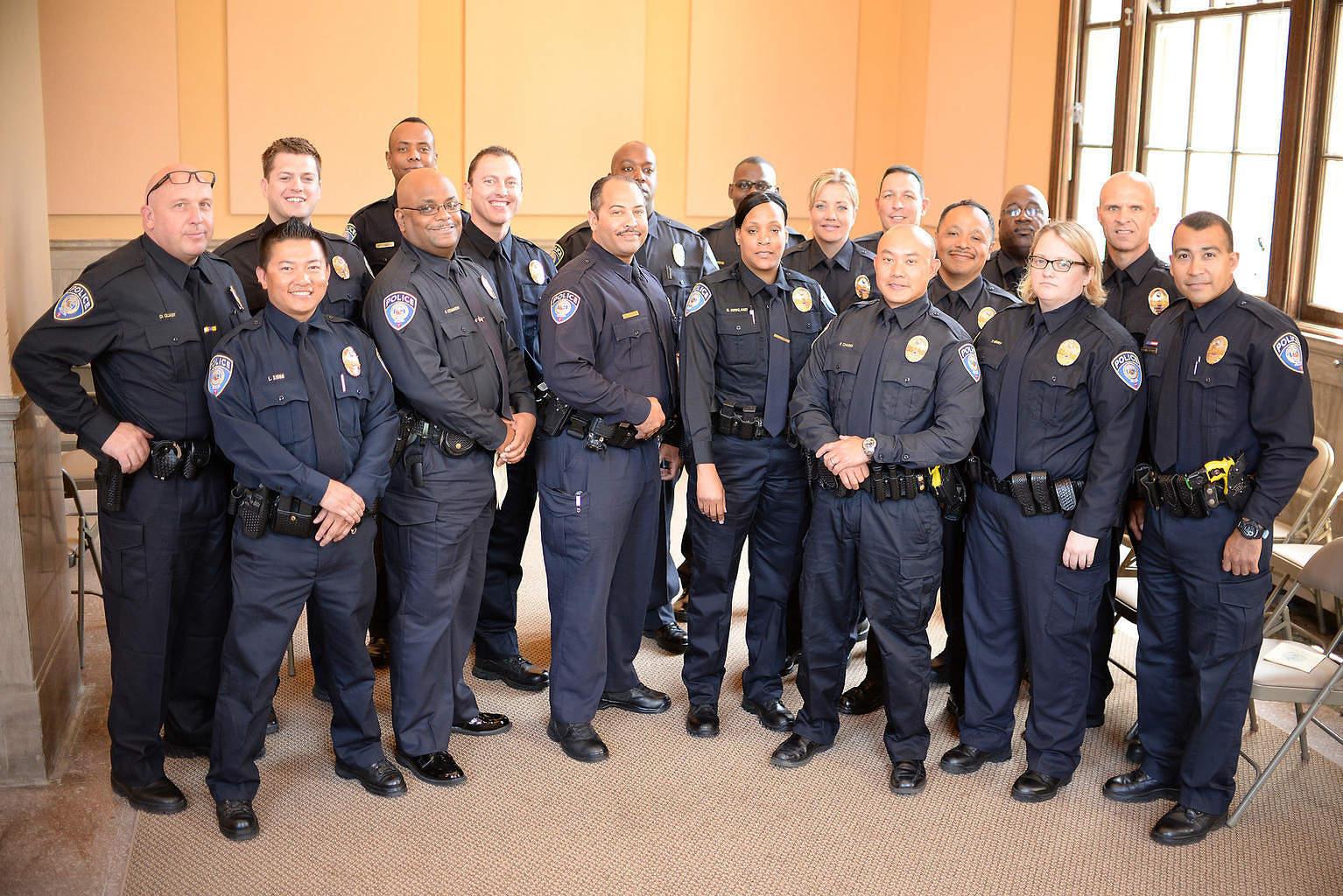 Metro Transit officers pose for a photograph after receiving their badges after the Promotions & Swearing In Ceremony in 2014.
