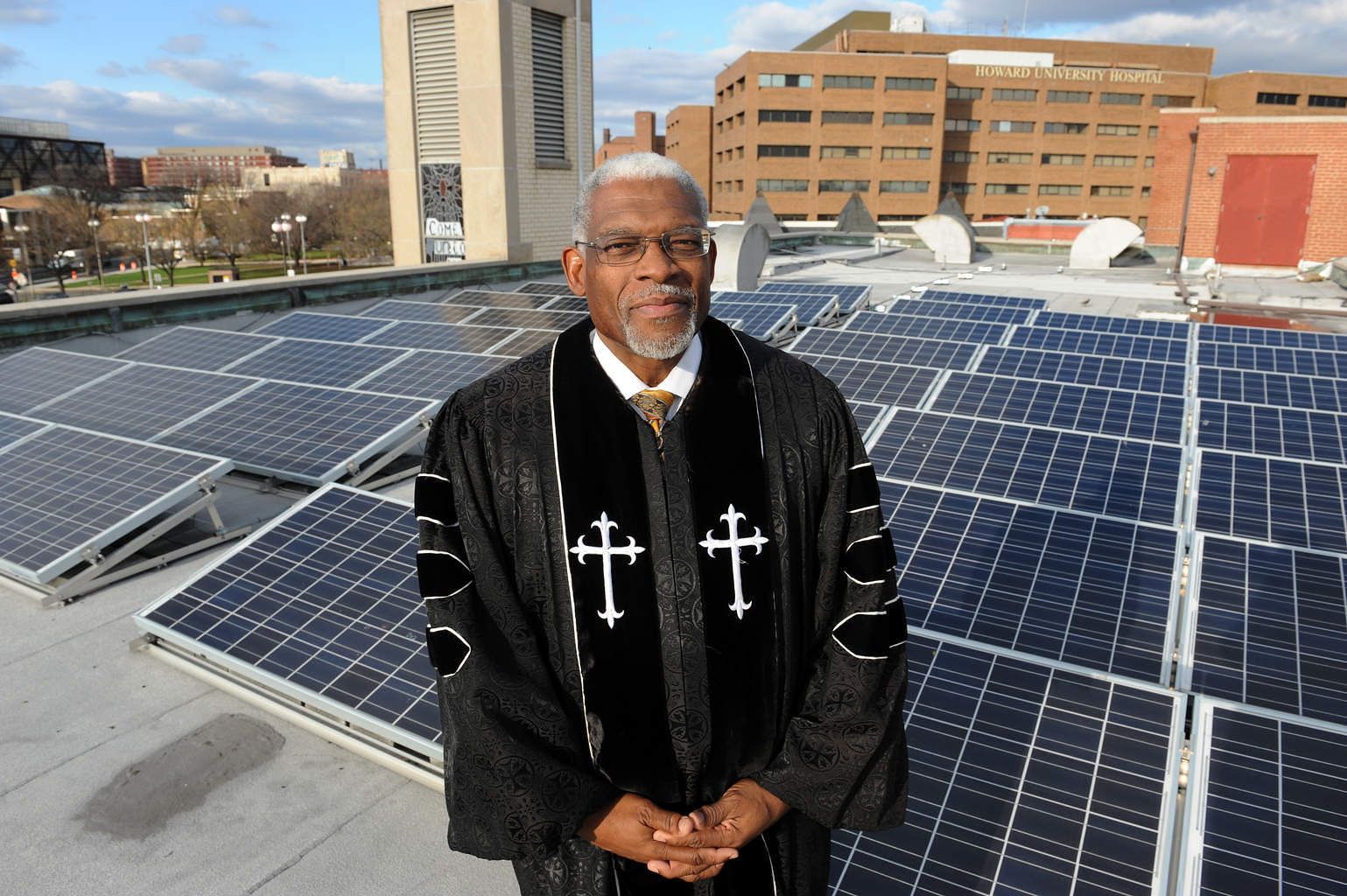 Washington, DC, USA--Rev. Dr. Earl D. Trent Jr., Senior Pastor at Florida Avenue Baptist Church stands among the solor panels that are on top of the church roof.  Jocelyn Augustino/Urban News Service