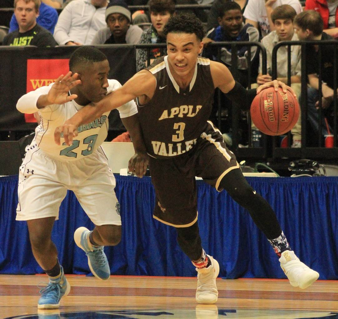 Blaine's Byron Bynum (23) guards Apple Valley guard Tre Jones during his team's Class AAAA quarterfinal game.