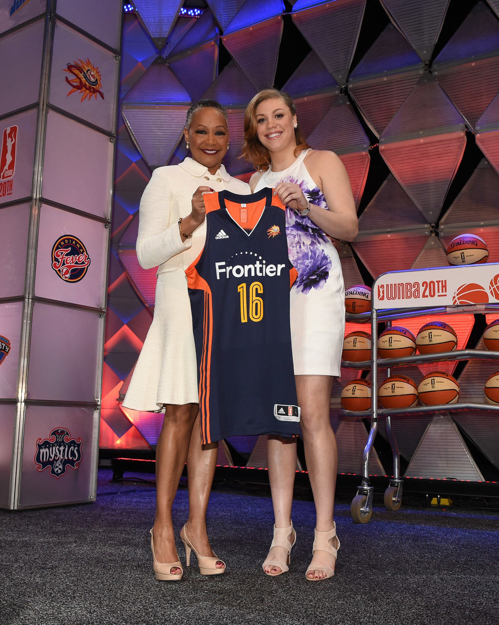 UNCASVILLE, CT - APRIL 14:  WNBA President Lisa Borders poses with Rachel Banham after being drafted number four overall by the Connecticut Sun during the 2016 WNBA Draft Presented By State Farm on April 14, 2016 at Mohegan Sun Arena in Uncasville, Connecticut.