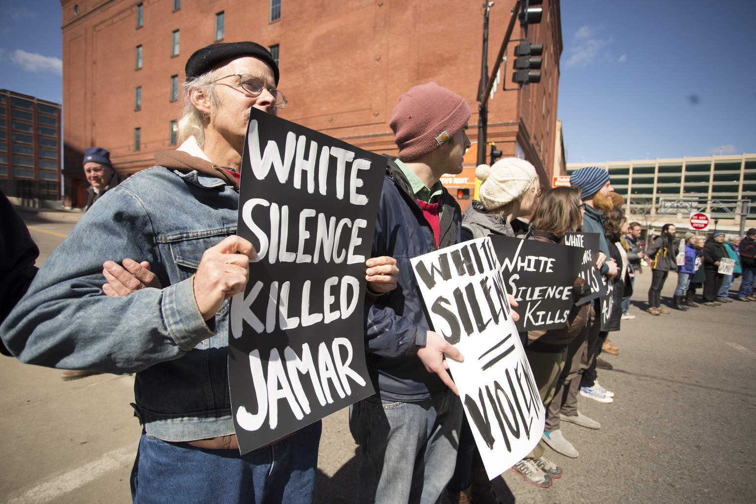 Protesters assemble in a line in front of the light rail and Twins Stadium in Minneapolis, MN on April 11th, 2016.