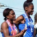 (l-r) Jia Lewis (Minneapolis Edison), second-place finisher in the 100, and first-place winner T'Nia Riley (Minneapolis North) after receiving their medals