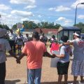 Community members gathered at the intersection of Lowry and Penn avenues where two toddlers were shot Thursday.