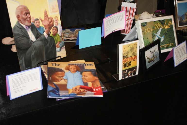Children's books by Justice Page were available for sale with proceeds to benefit Page scholars.