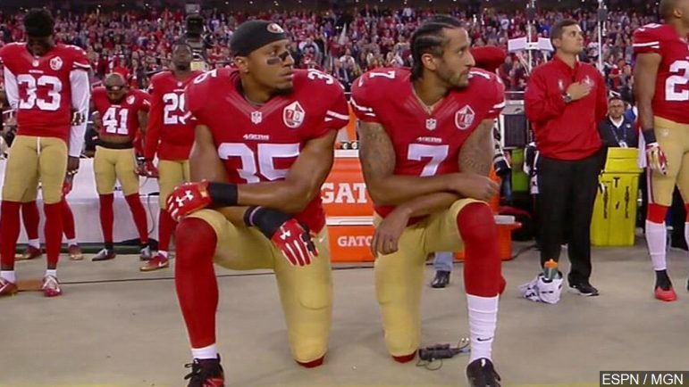 (l-r): Eric Reed and Colin Kaepernick taking a knee as national anthem plays Courtesy of MGN Online