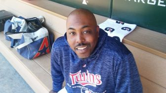 Twins' first Black pitching coach misses time with family