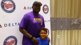 A rare father-son sight at the ballpark