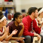 Natalie Williams, center, with St. Mary's players on the bench \\ Photo courtesy of St. Mary's Athletics